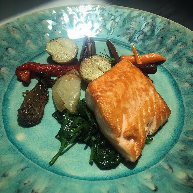 Charcoal grilled salmon with vegetables.