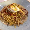 Spaghetti Carbonara ($17)  Spaghetti cooked to perfection with crispy bacon 🥓 , white wine 🍷, parmesan cheese.