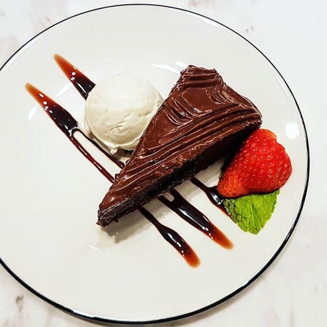 Homemade chocolate pudding fudge cake with gelato, strawberry and mint...