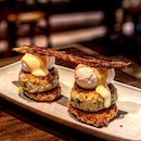 Low Country Crab Cake Benedict: Fried Green Tomato, Poached Farmer's Eggs, Charred Hollandaise Sauce And Smokey Bacon! ($30)