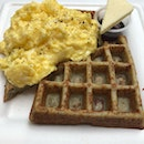 Gluten Free Waffles With Scrambled Eggs & Tomato Paste And Butter With Maple Syrup $16