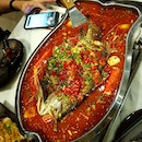 Spicy Grilled Seabass (金目鱼) with kungfu noodles + 欠揍的茄子 (brinja) 👍  not his mala version though 😅 .