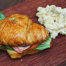 [Buck Tile Street Cafe] - Croissant Sandwich with bacon n ham, and scrambled egg at the side.