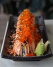 [Bao Makers] - The Salmon Mentaiko Roll ($16.80) features a maki rolls wrapped around crabsticks and crunchy cucumber pieces, before being topped with blow-torched salmon and drenched in a rich pool mentaiko sauce and generous tobiko atop.
