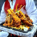 [Indian Express] - Kashmiri Lamb Rack Wazwan ($14) that made a rather dramatic entrance with the lamb racks smoking in its own juice and marination.