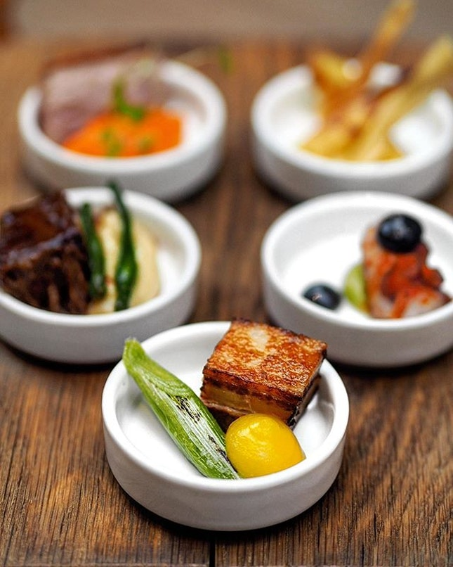 [Ash & Elm] - Le Porc - this classic dish of pork belly is slow cooked in duck fat to achieve a tender consistency, crisp exterior, and its rich flavours are balanced with the tangy flavour of orange and piquant charred leeks.