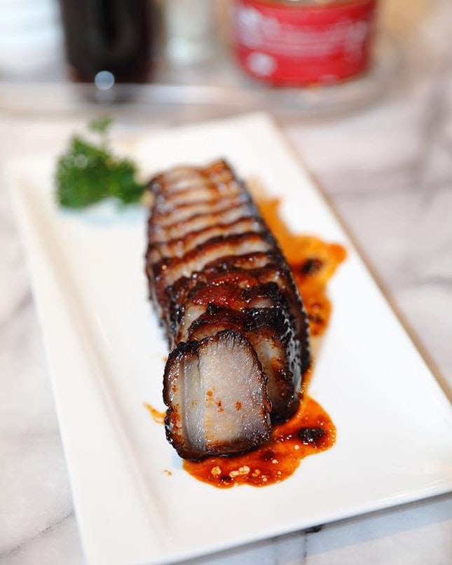 [Ho Fook Hei] - The fatty cut and the glossy dark coat of the Honey-Glazed Black Barbeque Pork Belly ($13) resembles the crystal char siew with its translucent meat.
