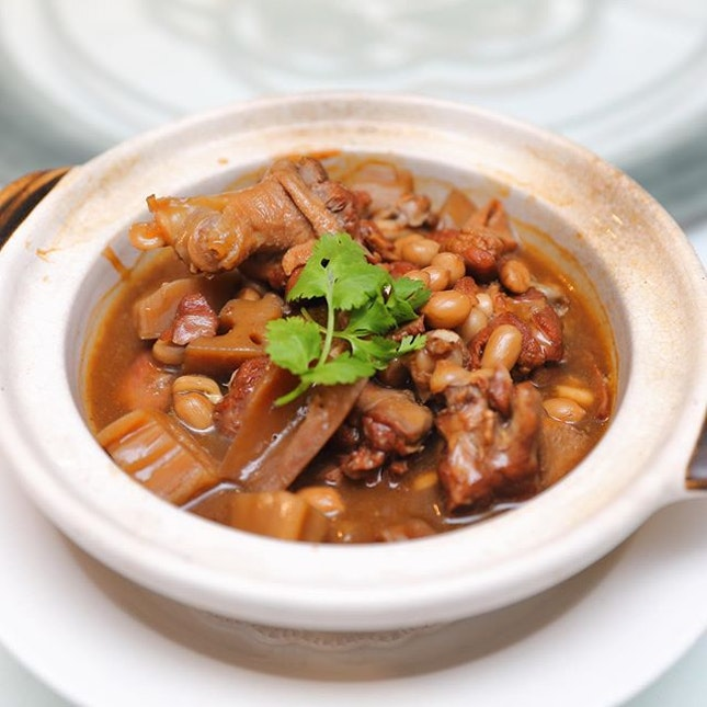 [Min Jiang] - The Slow-braised Duck with Fermented Beancurd, Lotus Root and Peanut ($26/$48) calls for a bowl of porridge to go with it.
