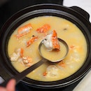 [Yan] - For something comforting, there is the House Special Local Lobster Porridge with Clams and Puffed Rice.