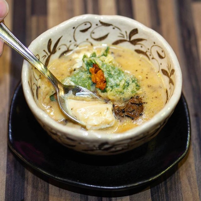 [Uni Gallery] - The Uni Tempura Truffle Chawanmushi features a crispy Uni Tempura with shaved winter truffle on a delicate and soft steamed egg custard.