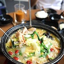 [Flaming Chicken Hotpot] -  chicken white pot comes with ingredients such as tender chicken pieces, pig stomach and red dates.