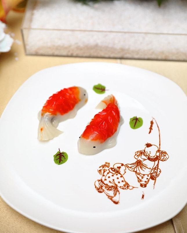 [Min Jiang] -  customers can complete the reunion meals on a sweet note with the Fortune Koi Fish 'Nian Gao' with Red Bean Paste ($9.80++ for 2pc dine-in/ $39.40 takeaway box of 8pc).