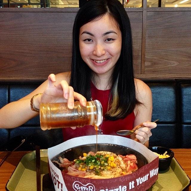 Girlfriend having her favourite pepper beef rice.