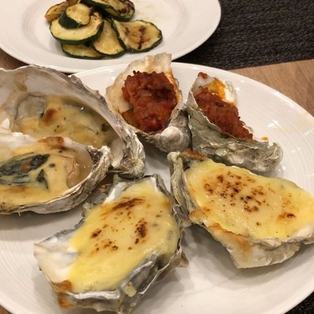Assorted baked oysters and surf and turf, which is quite yums.
