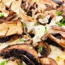 Mushroom pizza at Atlas Pizzeria.