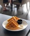Full Waffle with Sea Salt Butter & Syrup ($10.80)