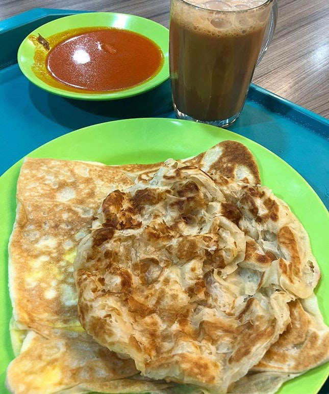 Having 1 plain and 1 egg #prata and a cup of #TehTarik as my #breakfast #burpple