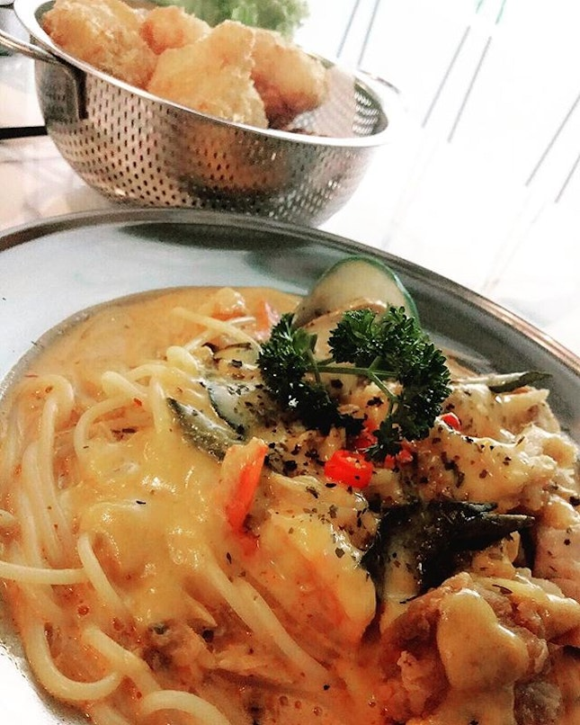 Tom Yum Salted Egg Pasta with Chicken Cutlet ($16.90), Fish bites ($9.90).