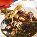 Lamb Kut Teh, served with rice and 2 lamb ribs ($5.50).