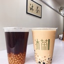 Pi Pa Gao Oolong Tea ($3.50) with White Pearls (+$0.50), Double Pearls Brown Sugar Milk Tea ($3.80).