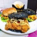 "Salted egg sotong ""blur""ger ($11.80), Fish skin salted egg pork burger ($14.80), Green apple curry burger ($14.80)."