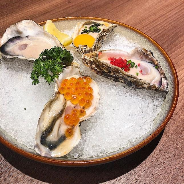Hiroshima oysters (infused with ikura-$6, natural-$5, okinawa umibudo aka sea grapes with quail egg and dashi shoyu-$8, Australia lime caviar-$7).